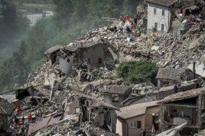 Rescuers work following an earthquake in Pescara del Tronto, central Italy. REUTERS/Adamo Di Loreto